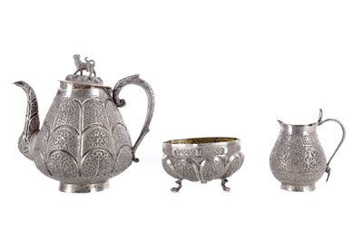 Lot 862 - AN INDIAN WHITE METAL THREE PIECE TEA SERVICE