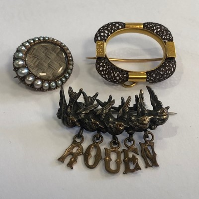 Lot 6-A LOT OF TWO MOURNING BROOCHES AND ONE OTHER