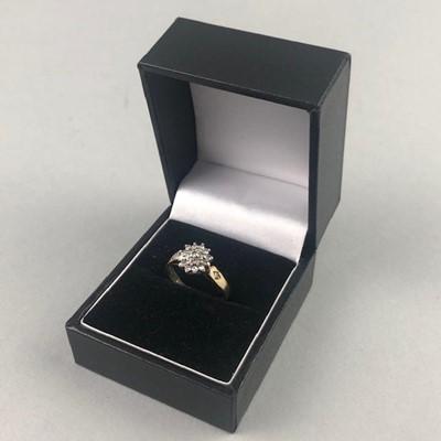 Lot 4-A NINE CARAT GOLD DIAMOND CLUSTER RING