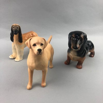 Lot 24-A BESWICK FIGURE OF A DACHSHUND AND TWO OTHER DOGS