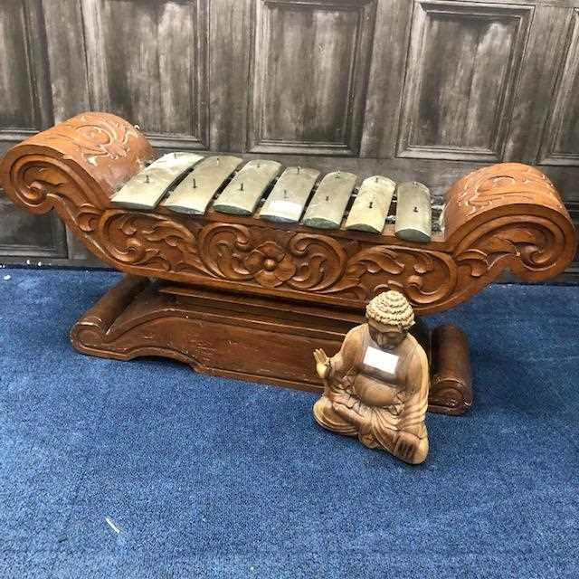 Lot 822 - A CARVED WOOD GONG AND A BUDDHA