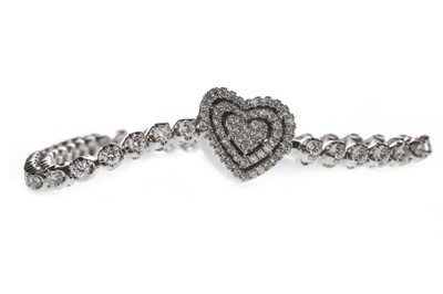 Lot 1319 - A DIAMOND HEART BRACELET