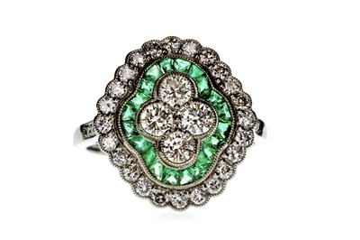 Lot 802-AN EMERALD AND DIAMOND RING