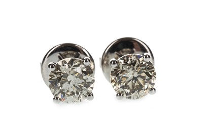 Lot 1301 - A PAIR OF DIAMOND STUD EARRINGS