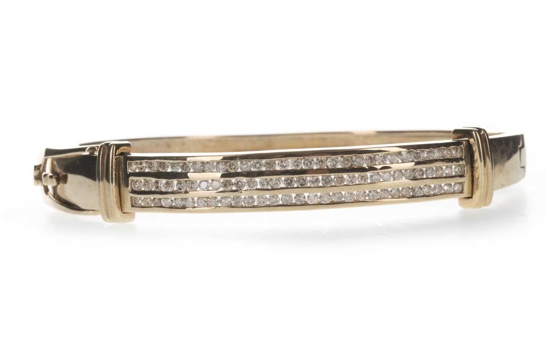 Lot 1302 - A DIAMOND BANGLE