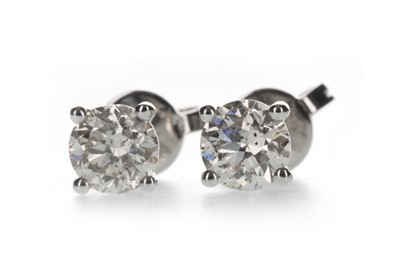 Lot 1317 - A PAIR OF DIAMOND STUD EARRINGS