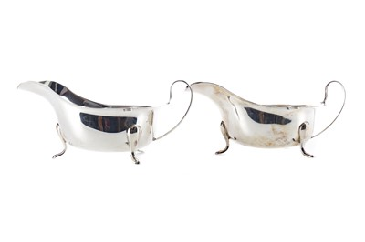 Lot 444 - A CASED PAIR OF SILVER SAUCE BOATS
