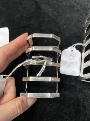 Lot 453 - A LOT OF THREE SILVER TOAST RACKS