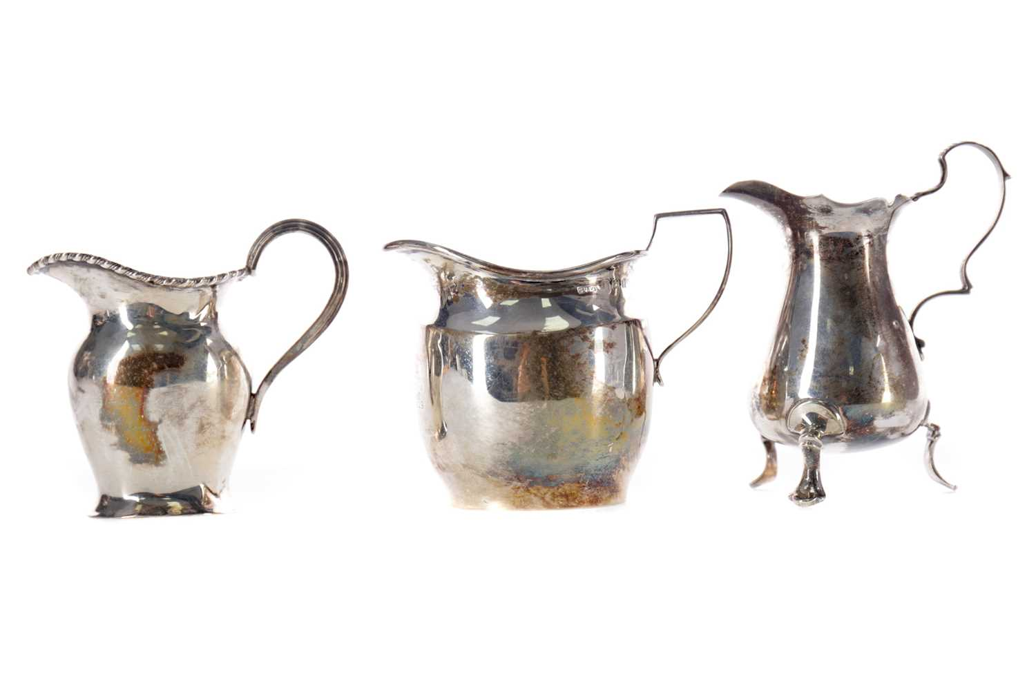 Lot 457 - A GEORGE V SILVER CREAM JUG AND TWO OTHERS
