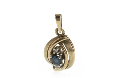 Lot 1328 - A BLUE GEM SET AND DIAMOND PENDANT