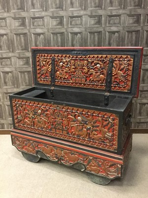 Lot 801 - AN EARLY 20TH CENTURY INDONESIAN CARVED WOOD DOWRY CHEST