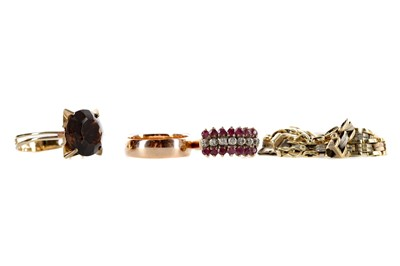 Lot 302 - THREE RINGS AND A BRACELET