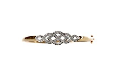 Lot 304 - A DIAMOND BANGLE