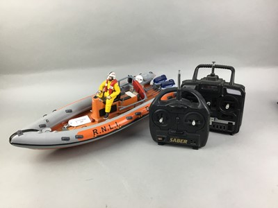 Lot 247 - A REMOTE CONTROL POND BOAT AND OTHER REMOTE CONTROLLERS