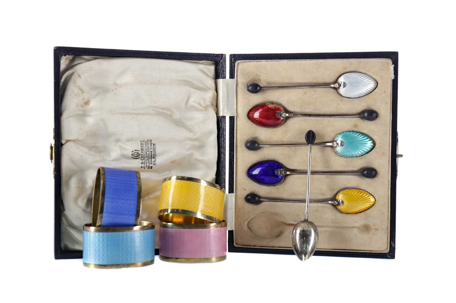 Lot 502 - A SET OF SILVER AND ENAMEL NAPKIN RINGS AND COFFEE SPOONS