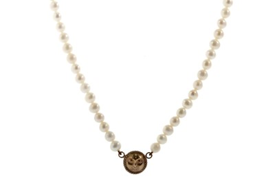 Lot 337 - A FAUX PEARL NECKLACE WITH GOLD MOON CHARM