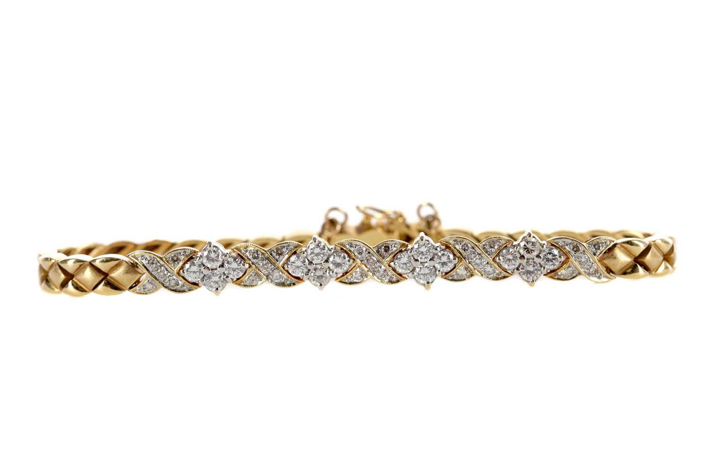 Lot 387 - A DIAMOND BRACELET
