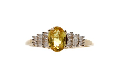 Lot 392 - A YELLOW SAPPHIRE AND DIAMOND RING