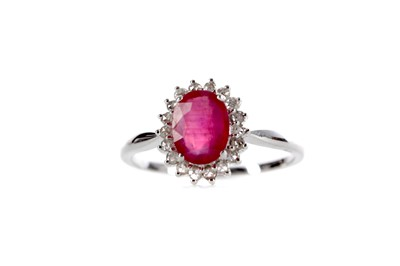 Lot 369 - A RUBY AND DIAMOND CLUSTER RING