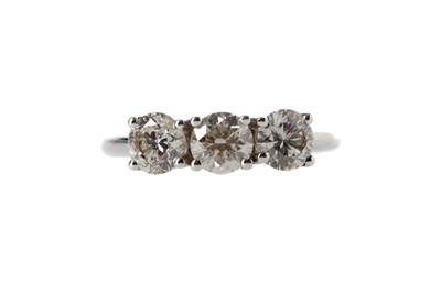 Lot 381 - A DIAMOND THREE STONE RING
