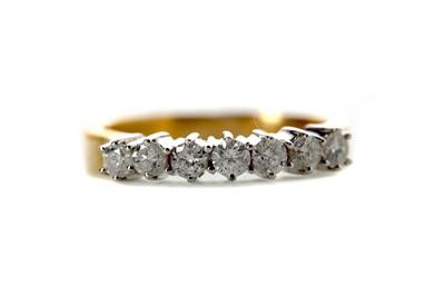 Lot 409 - A DIAMOND SEVEN STONE RING