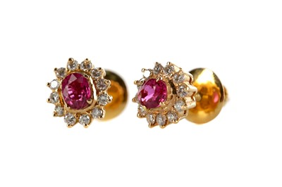 Lot 398 - A PAIR OF RUBY AND DIAMOND CLUSTER EARRINGS