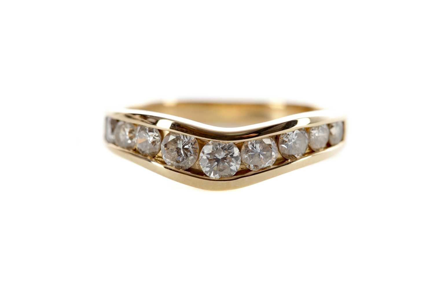 Lot 1310 - A DIAMOND NINE STONE RING