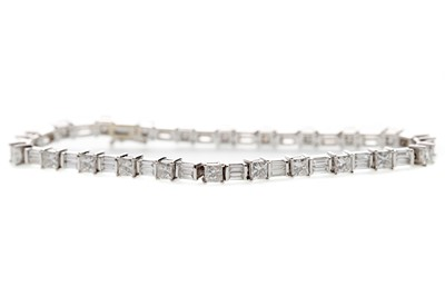 Lot 1312 - PRINCESS AND BAGUETTE CUT DIAMOND TENNIS BRACELET