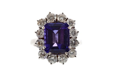 Lot 1322 - A TANZANITE AND DIAMOND RING