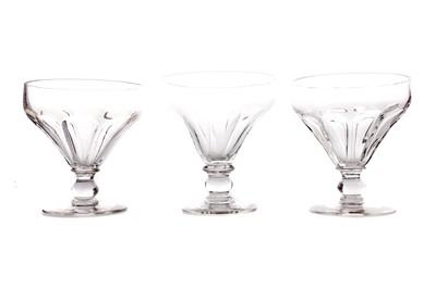 Lot 1052 - A COMPOSITE SET OF FIVE REGENCY GLASS RUMMERS