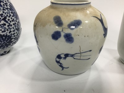 Lot 714 - A CHINESE BLUE AND WHITE VASE, TWO OTHER VASES AND A TEA POT AND A JAR