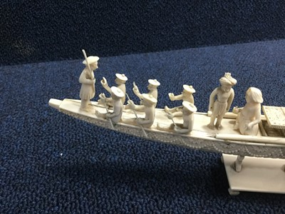 Lot 717 - AN EARLY 20TH CENTURY INDIAN IVORY CARVING OF A BOAT AND TWO FIGURES