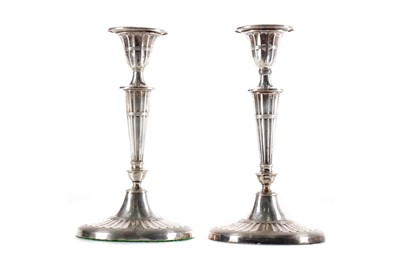 Lot 527 - A PAIR OF NEO-CLASSICAL SILVER CANDLESTICKS