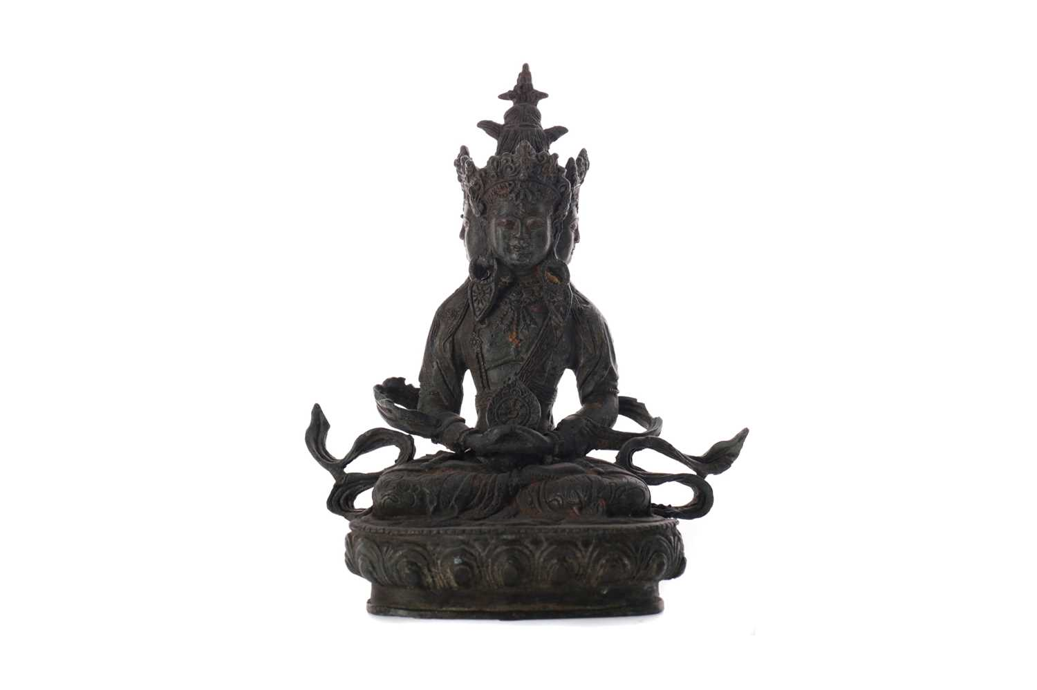 Lot 745 - AN EASTERN BRONZED FIGURE OF A SEATED DEITY