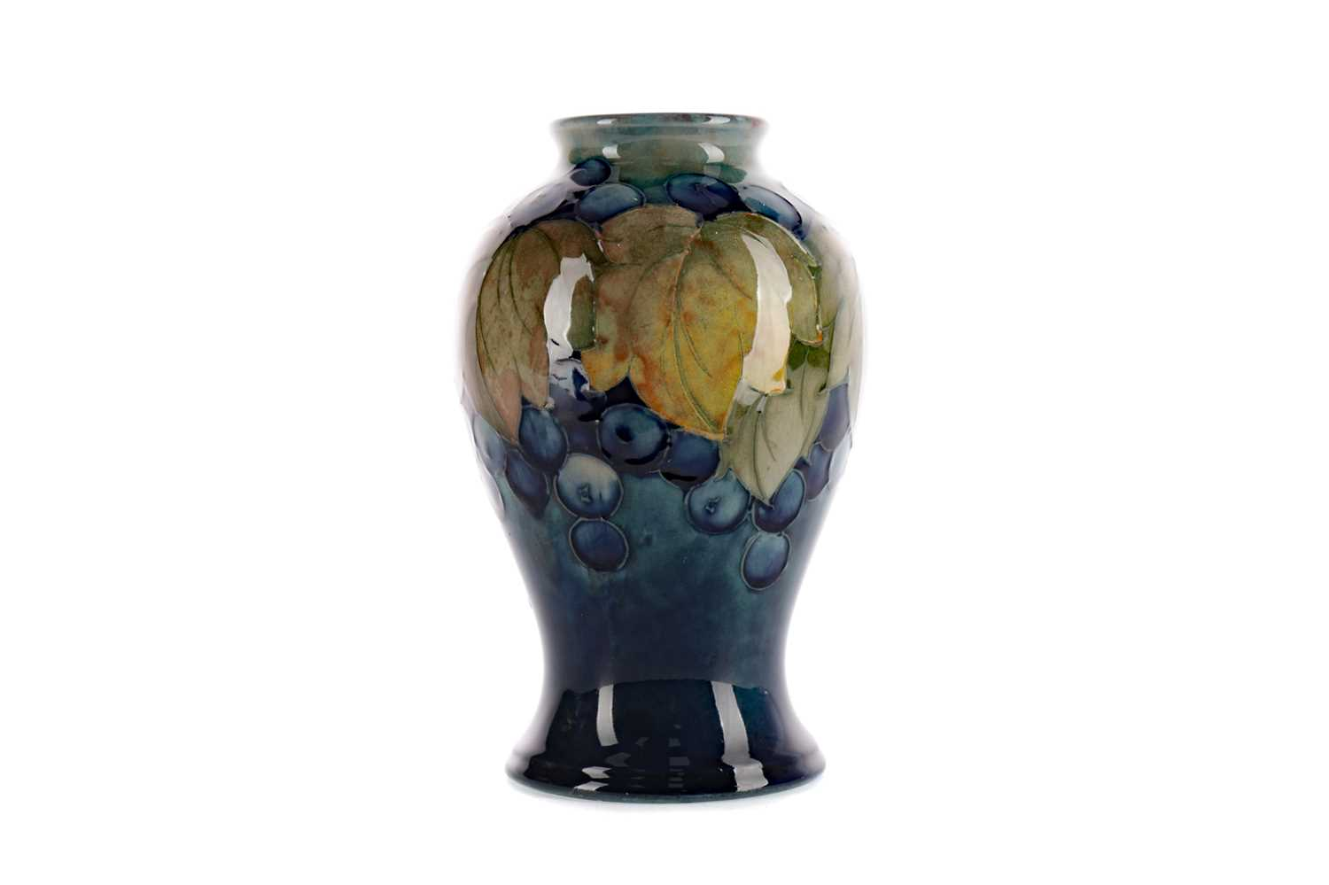 Lot 1086 - A MOORCROFT 'LEAVES AND BERRIES' PATTERN VASE