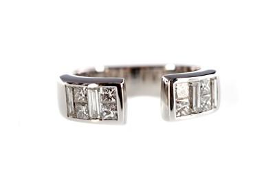Lot 1336 - A DIAMOND SET TORQUE RING