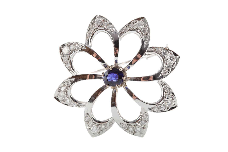 Lot 1355 - A BLUE GEM SET AND DIAMOND FLOWER BROOCH
