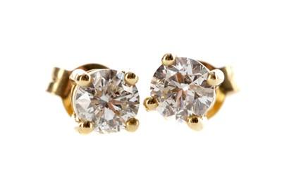 Lot 1363 - A PAIR OF DIAMOND STUD EARRINGS