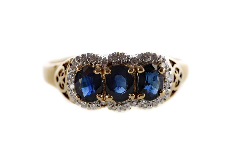 Lot 1374 - A BLUE GEM SET AND DIAMOND RING