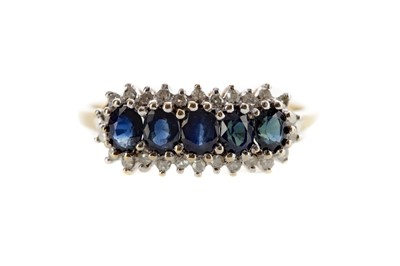 Lot 1377 - A BLUE GEM SET AND DIAMOND RING