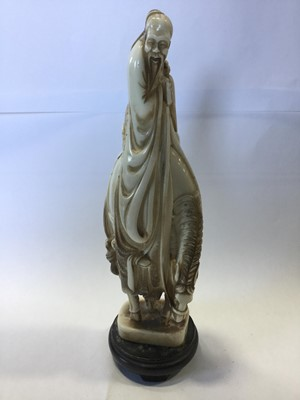 Lot 790 - AN EARLY 20TH CENTURY CHINESE CARVED IVORY FIGURE ON HORSEBACK