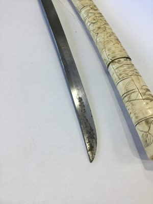 Lot 796 - AN EARLY 20TH CENTURY JAPANESE IVORY CASED SWORD