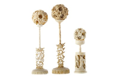 Lot 806 - A LOT OF THREE EARLY 20TH CENTURY CHINESE IVORY CONCENTRIC BALLS WITH STANDS