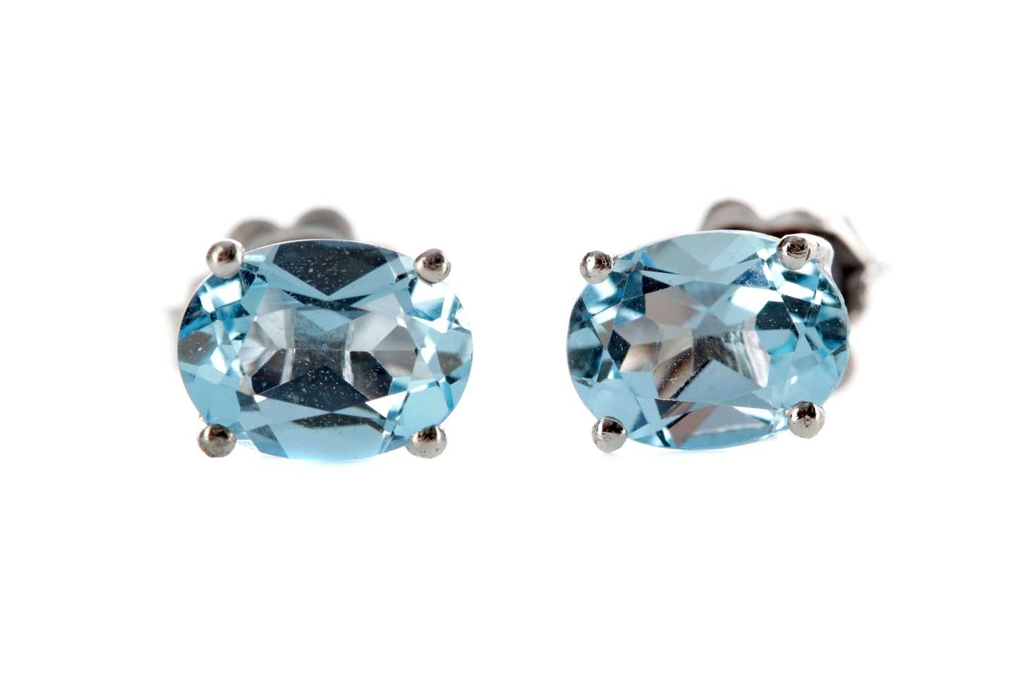 Lot 1390 - A PAIR OF BLUE TOPAZ STUD EARRINGS