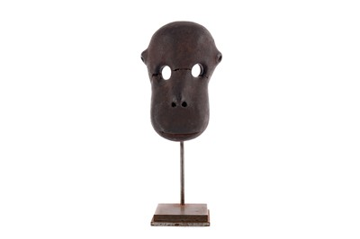 Lot 838 - AN AFRICAN POTTERY MODEL OF A MONKEY FACE