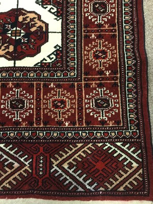 Lot 843 - PERSIAN FRINGED RUG, decorated in shades of...
