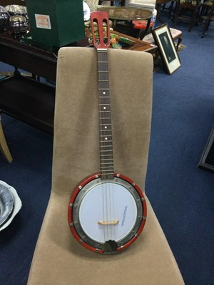 Lot 63 - A MUSIMA FOUR STRING BANJO