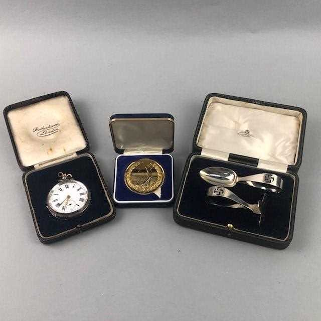 Lot 10 - A SILVER POCKET WATCH ALONG WITH A PUSHER SET AND A MEDAL