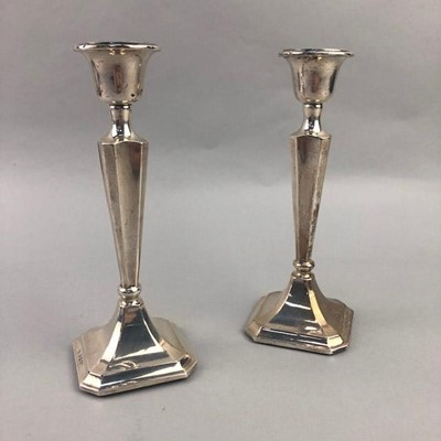 Lot 26 - A PAIR OF SILVER CANDLESTICKS