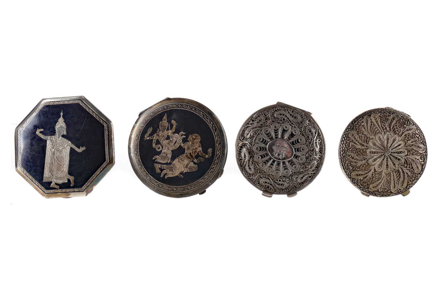 Lot 1713 - A THAI SILVER OCTAGONAL COMPACT AND THREE OTHERS